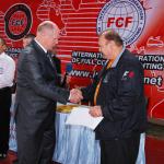 Вручение М. В. Грицаеву удостоверения члена президиума IF FCF
